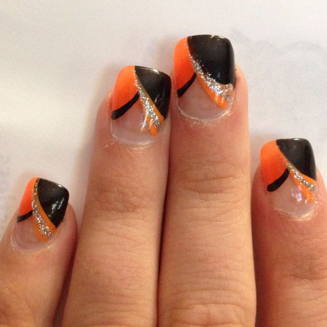 Orange and black nail art! I would like white where the ...