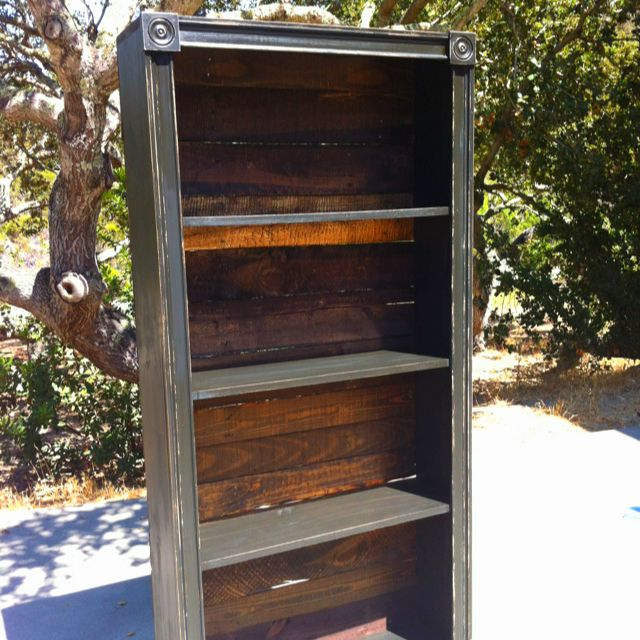 Homemade Bookshelf. Stained Pallet Wood Backing And