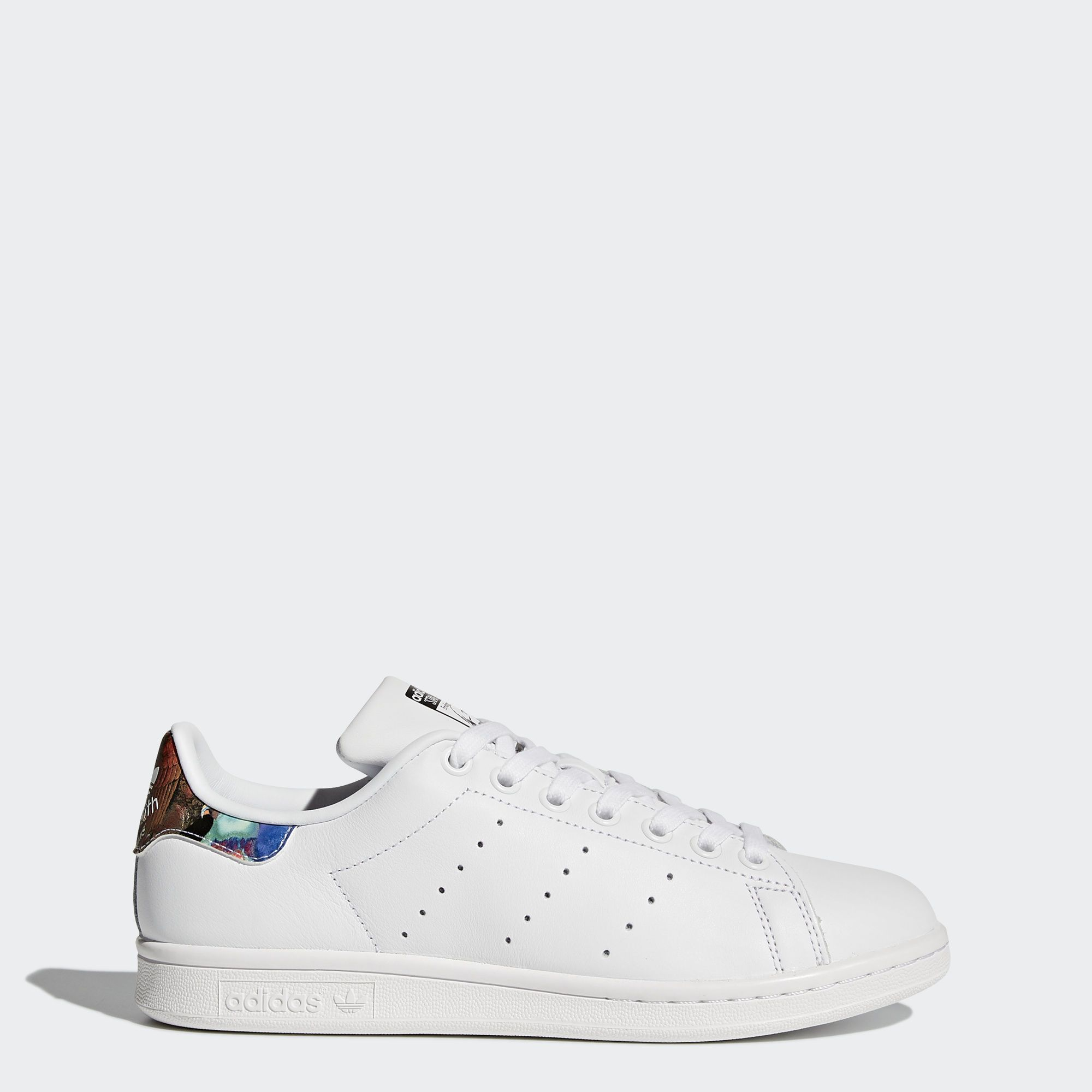 the latest 16fbf 8c7bc The clean, classic lines of the original Stan Smith infuse this version of  the style icon for an unmistakable build. Designed in collaboration with ...