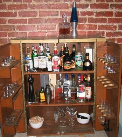 Attirant Liquor Cabinet....this Looks Like An Old VHS Cabinet One Of My Parents  Has... Hm... DIY Project?