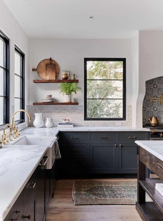 Beautiful two-toned kitchen with dark gray cabinets and open shelving | Amber Interiors