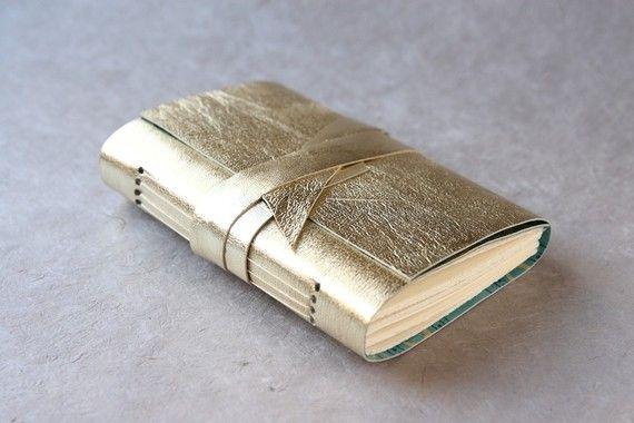 gold lambskin sketchbook, so pretty!http://www.etsy.com/listing/61142226/gold-lambskin-leather-journal-or