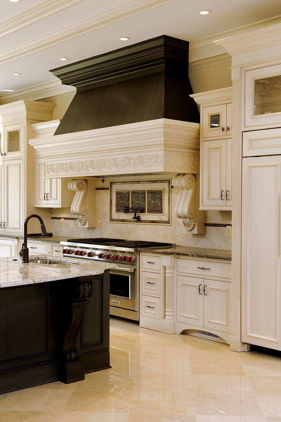 cabinets that look like furniture like the range the feature at the bottom of the cabinets