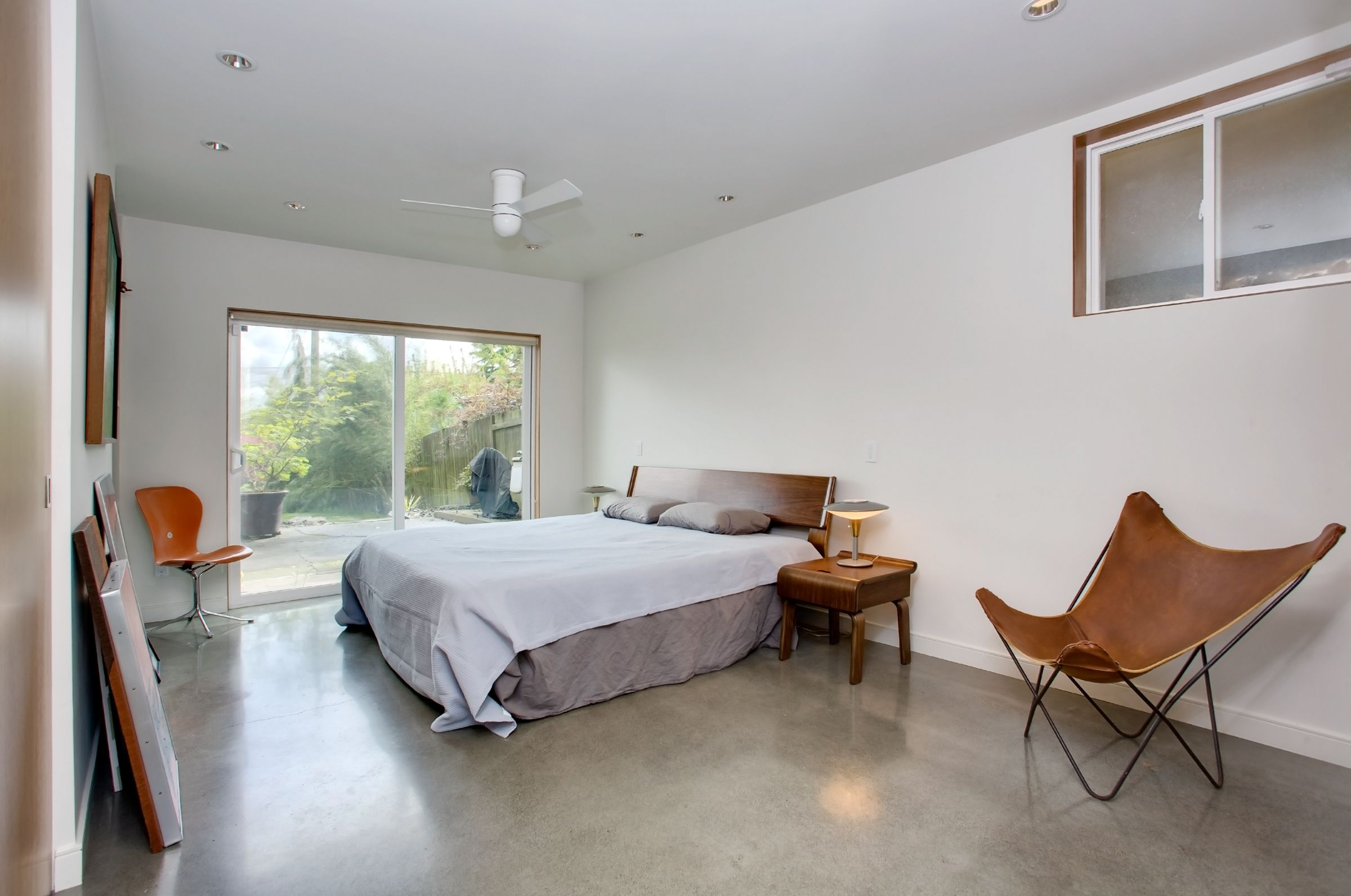 New master bedroom has polished concrete floors with