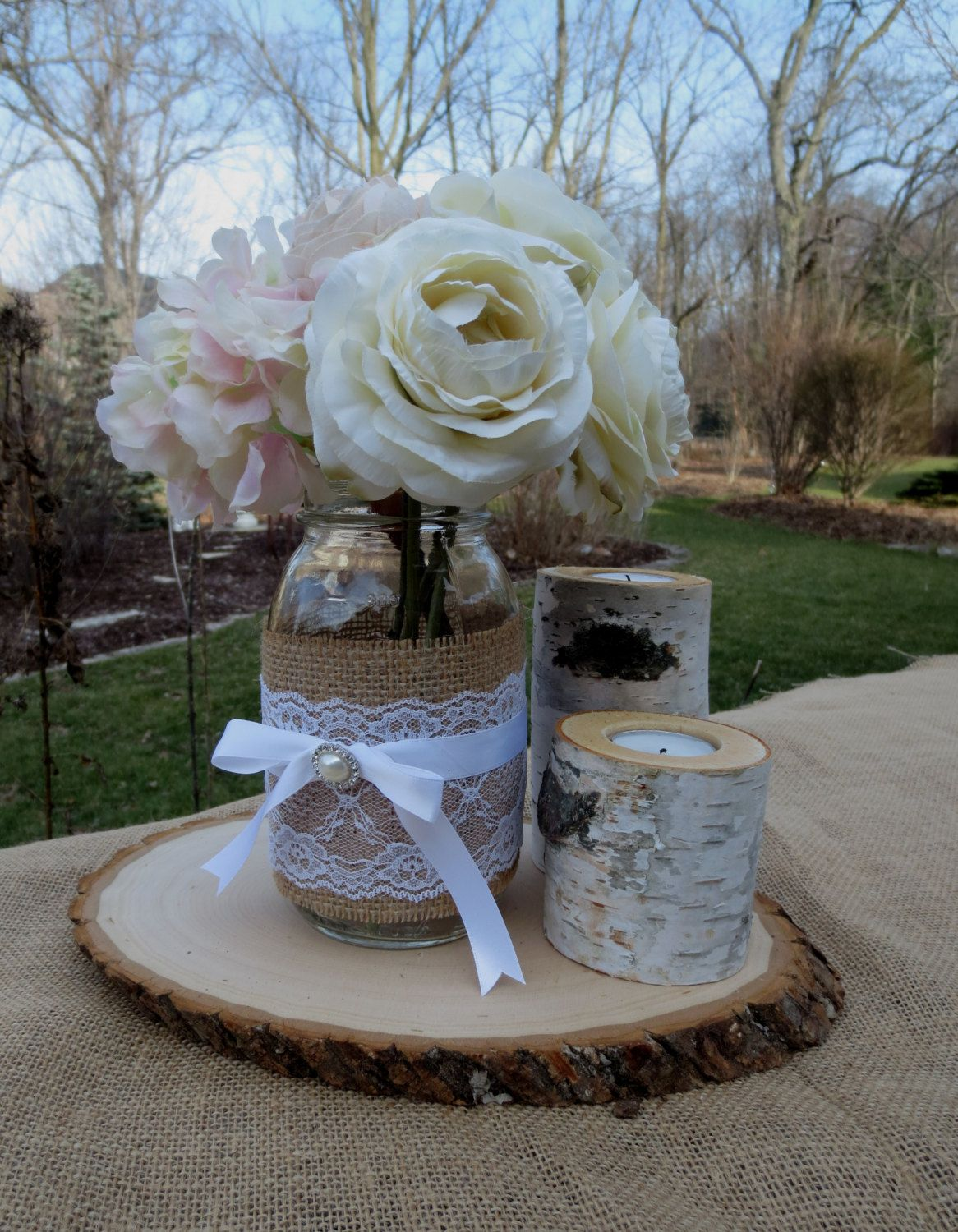 Mason jar with birch candles and wood slice wedding centerpieces