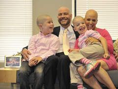 Laura Berman her family who are supporting her efforts fight cancer by also shaving their heads love for her their family.