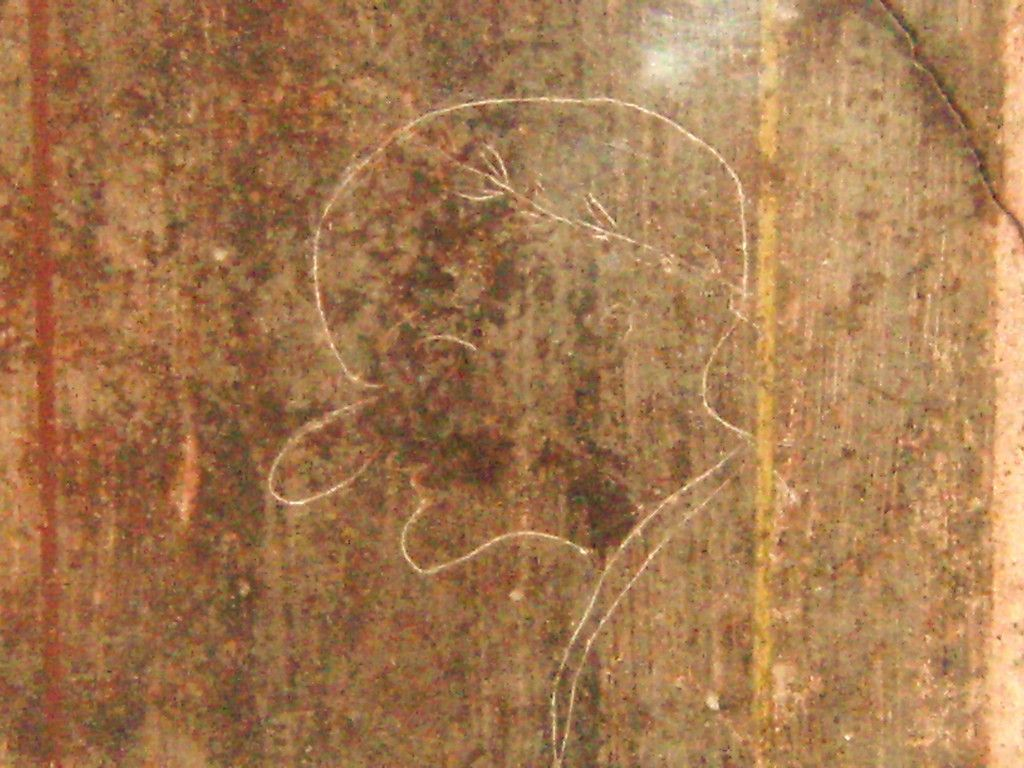 Roman Graffiti Located In The Villa Of Mysteries Pompeii The Subject Victim Of This Caricature Is Portrayed With A Pointy Chin Laurel Wreath