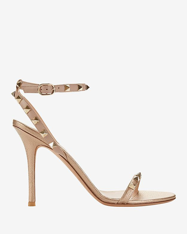331a42518347 Valentino Rockstud Ankle Strap Metallic High Sandal  Signature rockstuds  detail the single strap across the