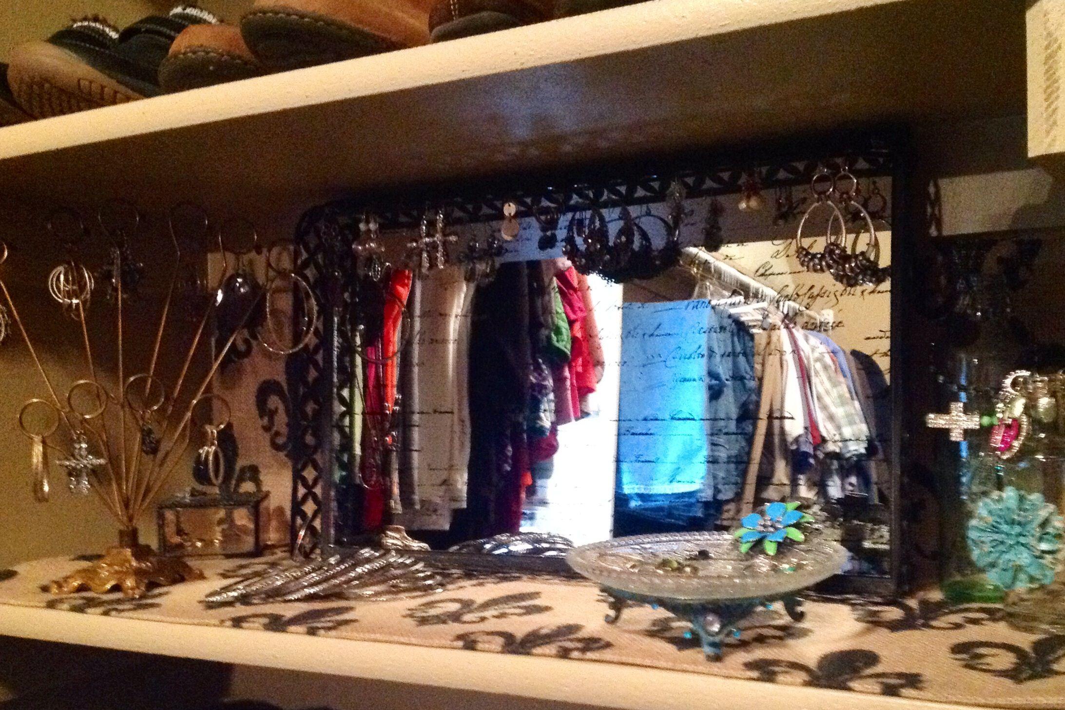 I used one of my shoe shelves to make a jewelry shelf.