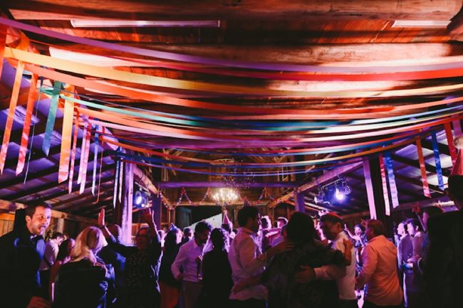 Lara Hotz Photography. Coloured ribbons strung across the roof of the Sunnybrook Barn at the Sydney Polo Club
