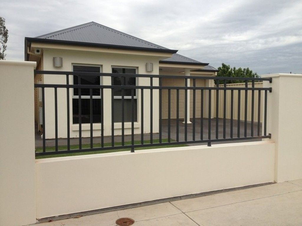 Outdoor design simple modern home with black iron fence for Simple fence plans