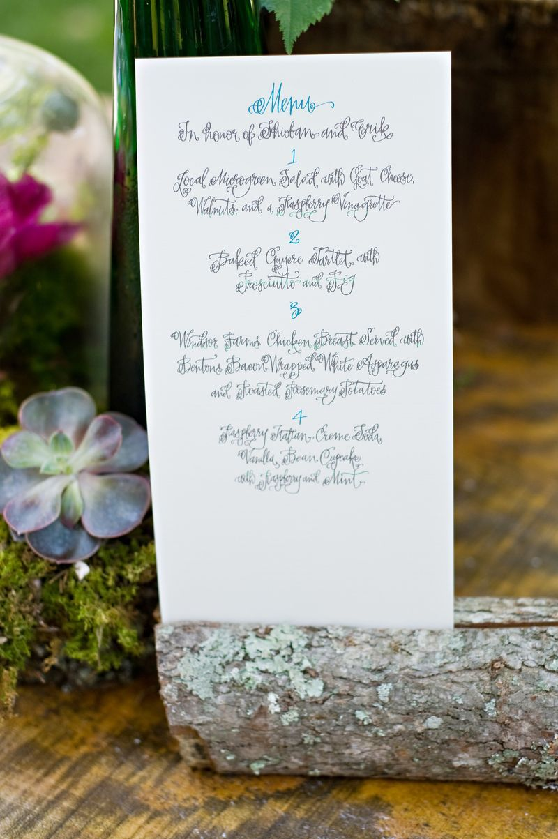 logs for holding wedding menus, table numbers etc.