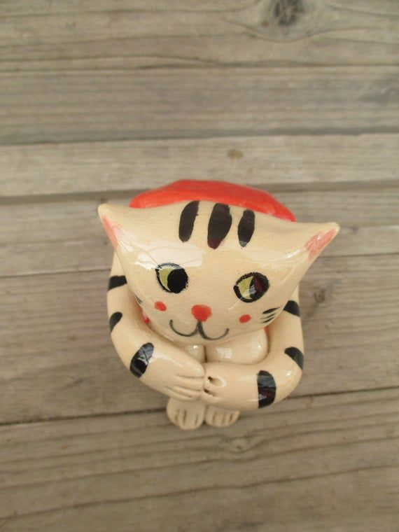 This Ceramic Cat is part of TatjanaCeramics design and is all hand made.  Being handmade each and every item is unique and one of a kind. It is made from a white stoneware, hand painted and glazed with the translucent glaze, which give the sculpture a crackle look. It is fired in a ceramic kiln at 1000 degrees Celsium. Size: length:  8 cm (3.2