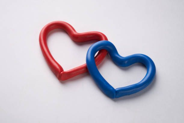 red and blue plasticine heart isolated on white background