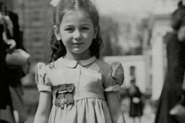 Tania Szabo, daughter of Violette Szabo, wearing the George Cross Medal  awarded to her