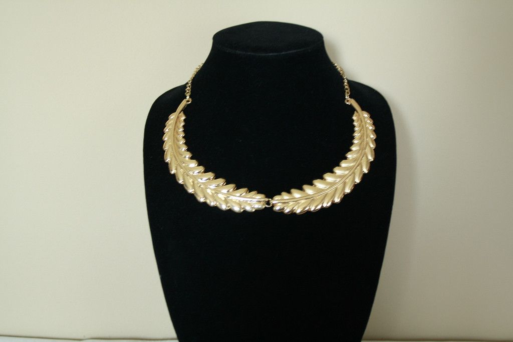 Feathered Collar Necklace  -- A wonderful necklace.  Come to ceesquared.ca This piece is great to go with any outfit.