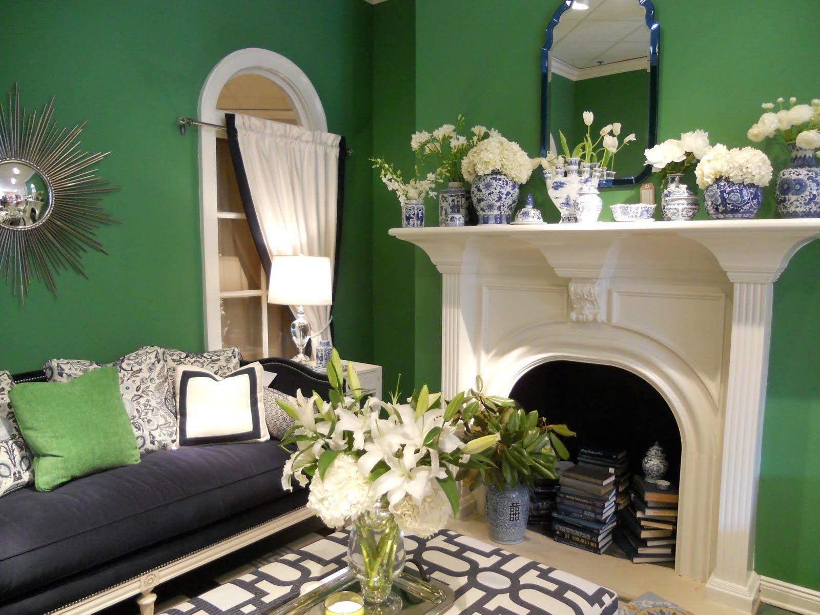 classic white fireplace offsetkelly green walls, competing