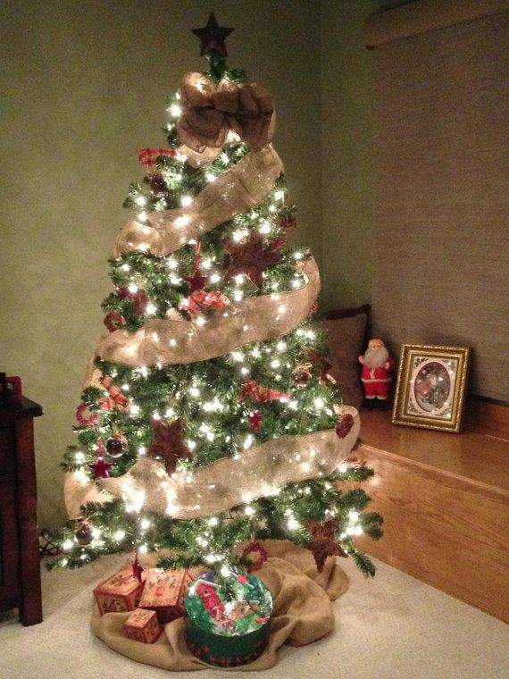 A natural colored tree topper bow of burlap bow is 10 for Christmas tree garland ideas