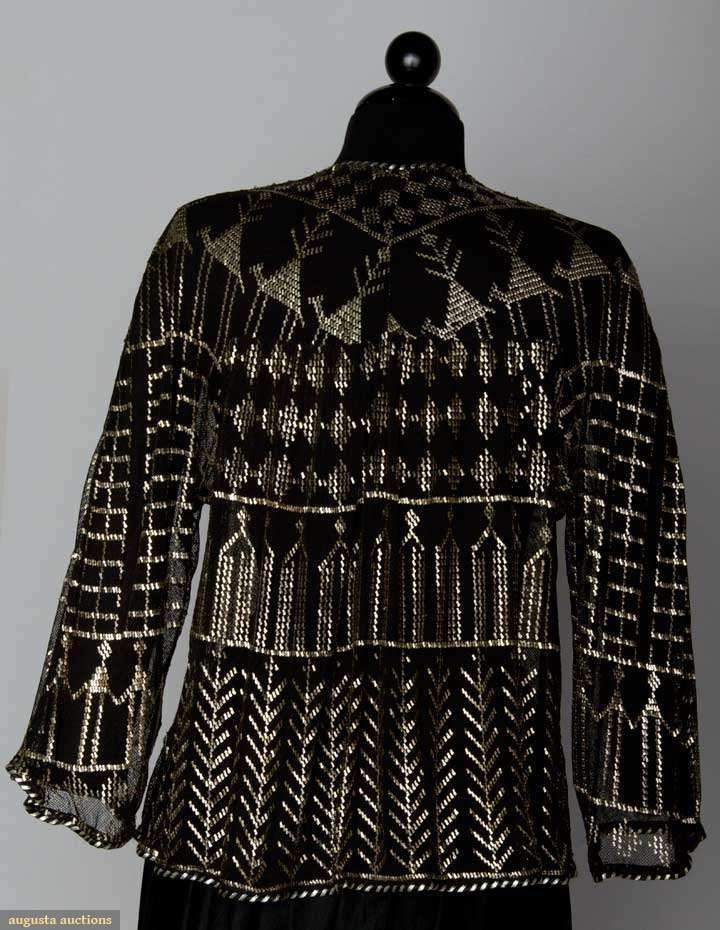 ASUITE EVENING JACKET, 1930s Black cotton net, applied silver metal in animal, plant & geometric designs. Back excellent. Back