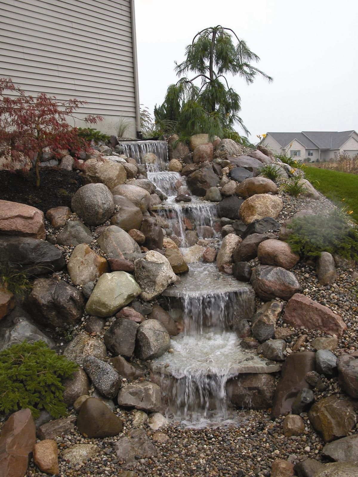 Small ponds water features on pinterest water garden for Waterfall garden feature