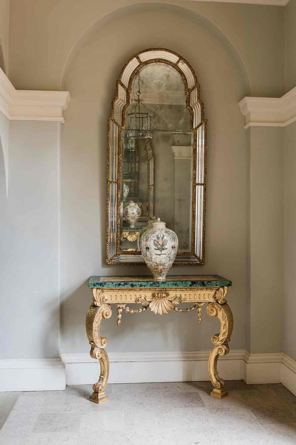 """[i]An ornate mirror and similarly detailed table occupy an alcove in one of the corridors.[/i]  Like this? Then you'll love  [link url=""""http://www.houseandgarden.co.uk/interiors/historic-interiors/historical-homes""""]Design Tips For Historical Homes[/link]"""