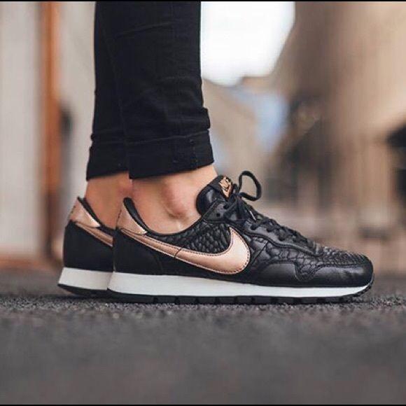 ebe069fbb0cd5 Nike Air Pegasus Black Rose Gold Sneakers •Quilted black leather and a rose  gold swoosh give these Nike sneakers a luxe feel. •Women's size 7, true to  size.