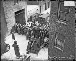 A Crowd Gathers In The Alley Behind 2122 North Clark Street Chicago