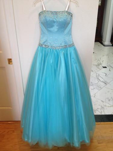 Powder blue, drop waist, strapless gown has a fitted bodice adorned with crystals and sequins. Full skirt has tulle overlay with crinoline underneath. Lace-up corset back. Only worn once, perfect condition. Fits 5'5