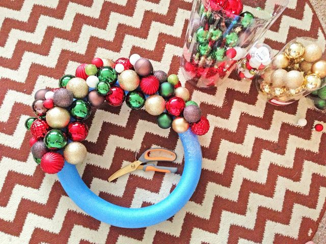 Grosgrain: DIY 30 Pool Noodle Ornament Wreath- you could glue all kinds of things on here instead of ornaments- it's just a cheap base #poolnoodlewreath