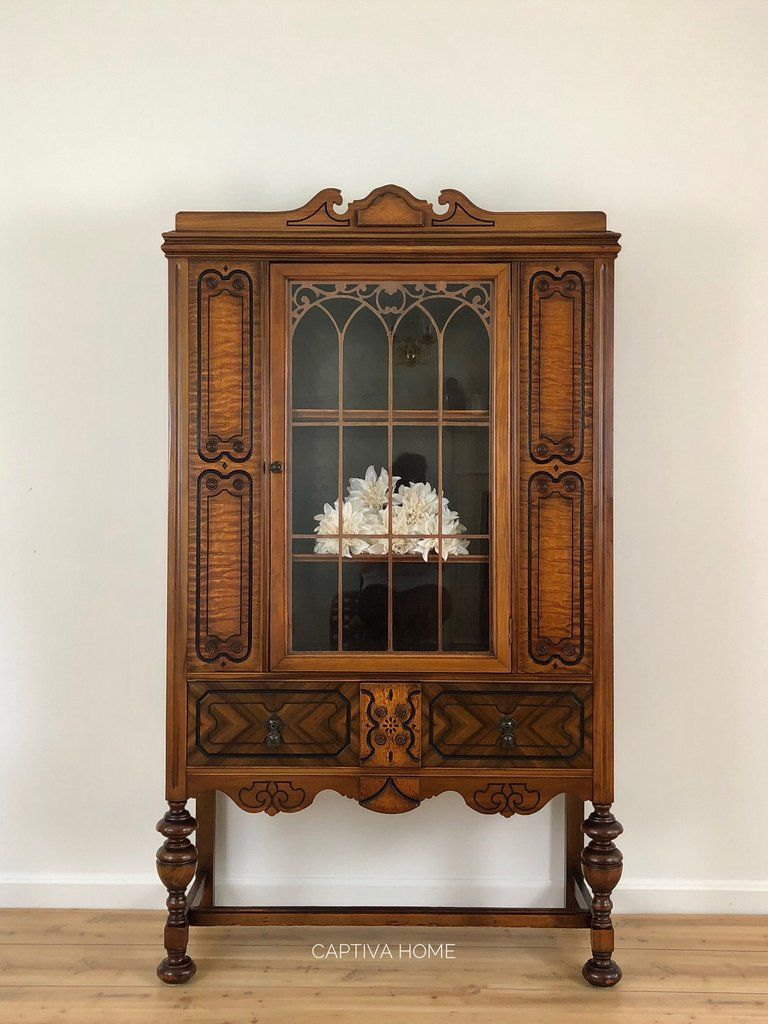 Antique jacobean china cabinet in thanksgiving decor