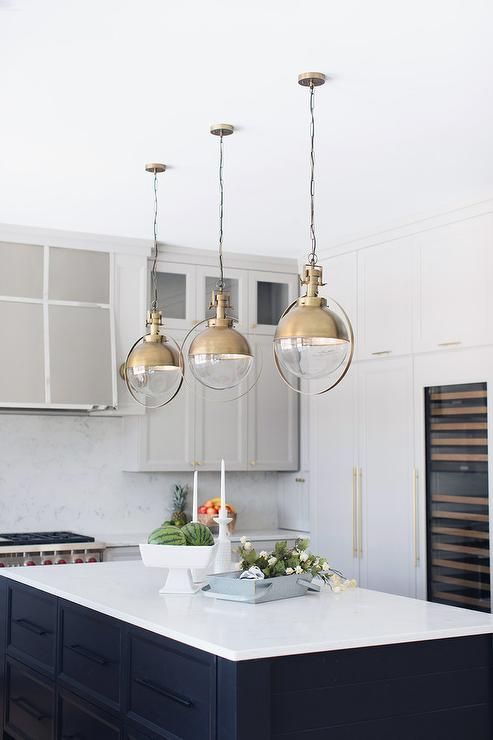 Beautiful Black And White Kitchen Features Three Vintage Style Glass And Brass Lights Mounted Kitchen Island Lighting Kitchen Pendant Lighting Kitchen Remodel