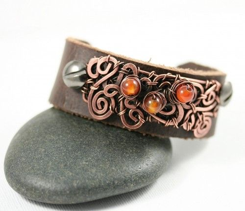 This Leather Cuff Bracelet with Copper Wire Wrap and Beads is a part of a series started this Winter (2012). I am in love with the fluidity of the designs capable with this technique. I am still playi