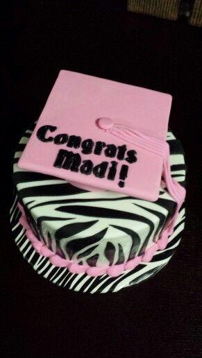 Pink and zebra graduation cake.