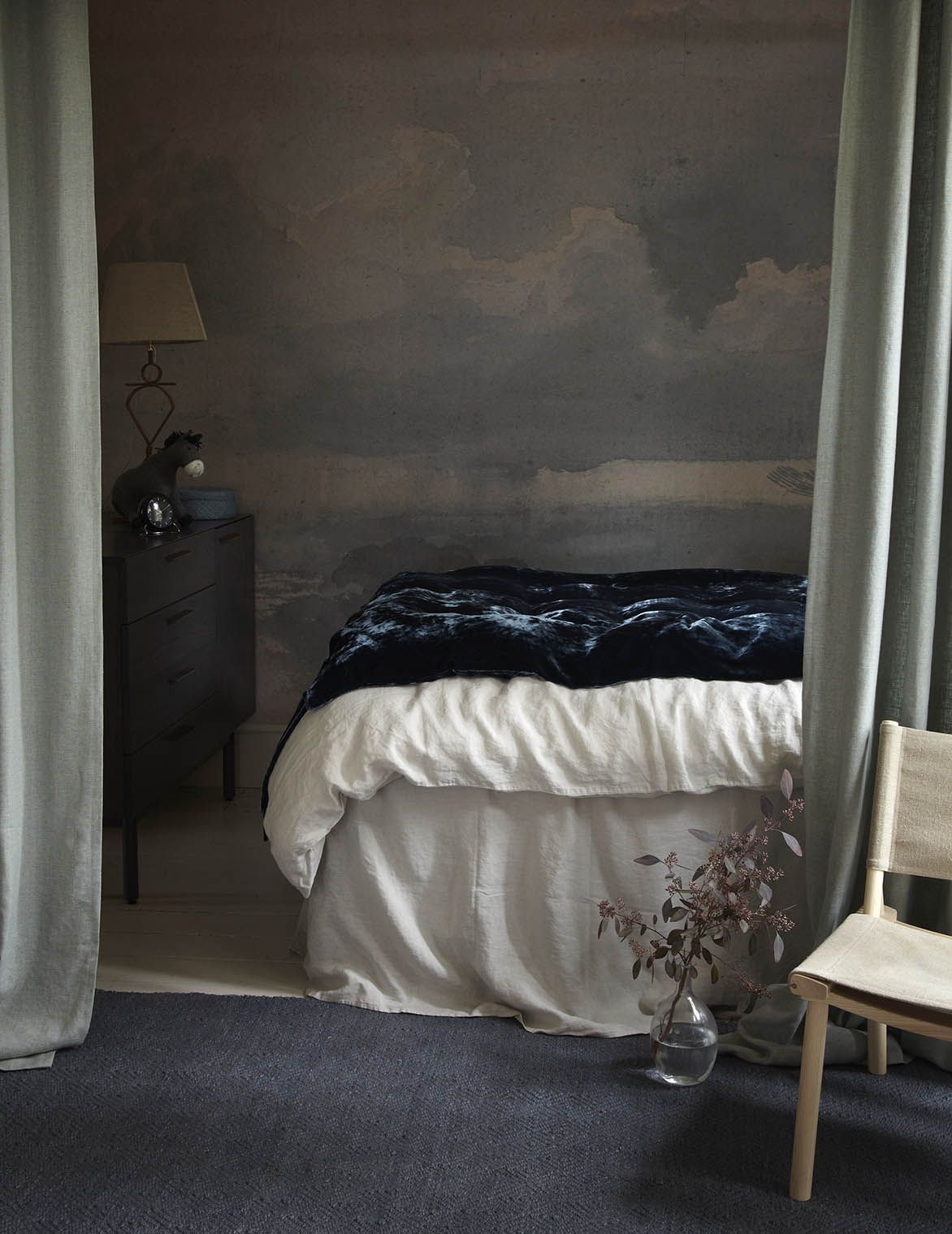 Decorating with pastel shades neednt mean going entirely pale an accent wall in a darker colour such as this deep blue used here serves to bala