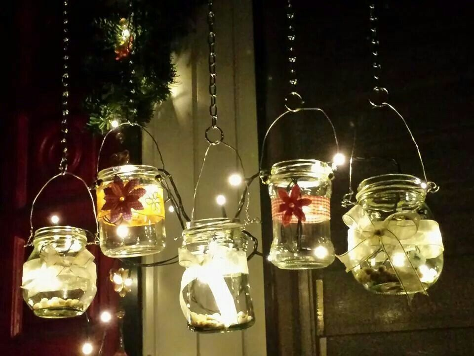 Hanging recycled glass lamps in my garden made mayo and cheez whiz jars.