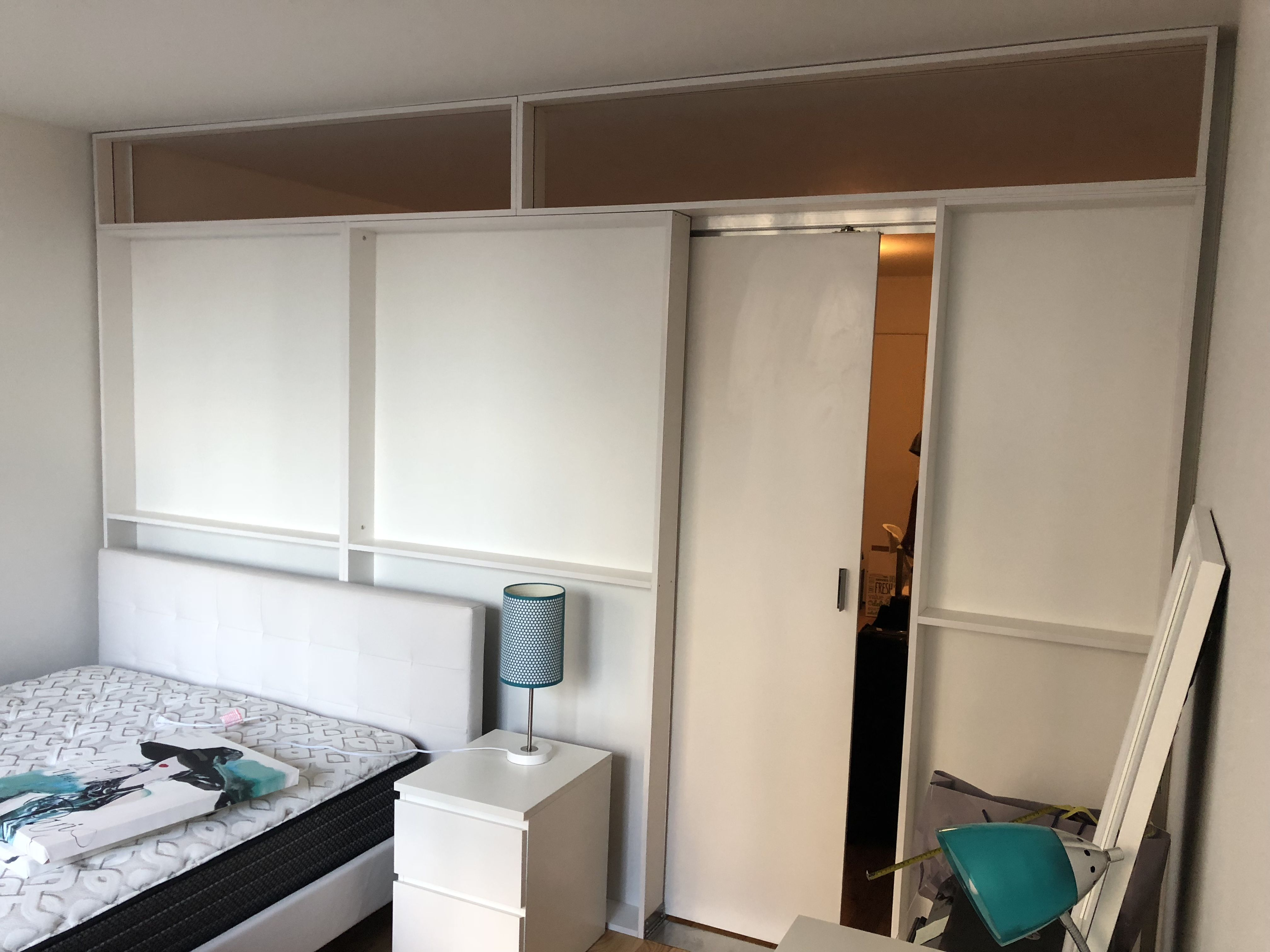 Free standing room divider with a door room divider