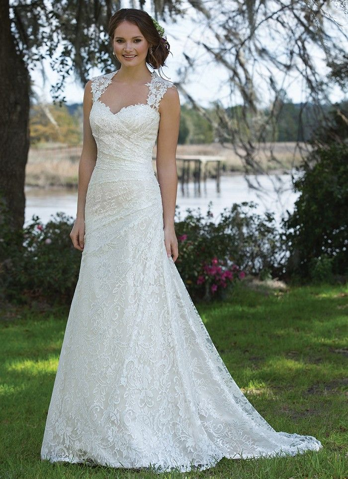 28a7f14702 An allover lace slim A-line gown featuring a Queen Anne neckline