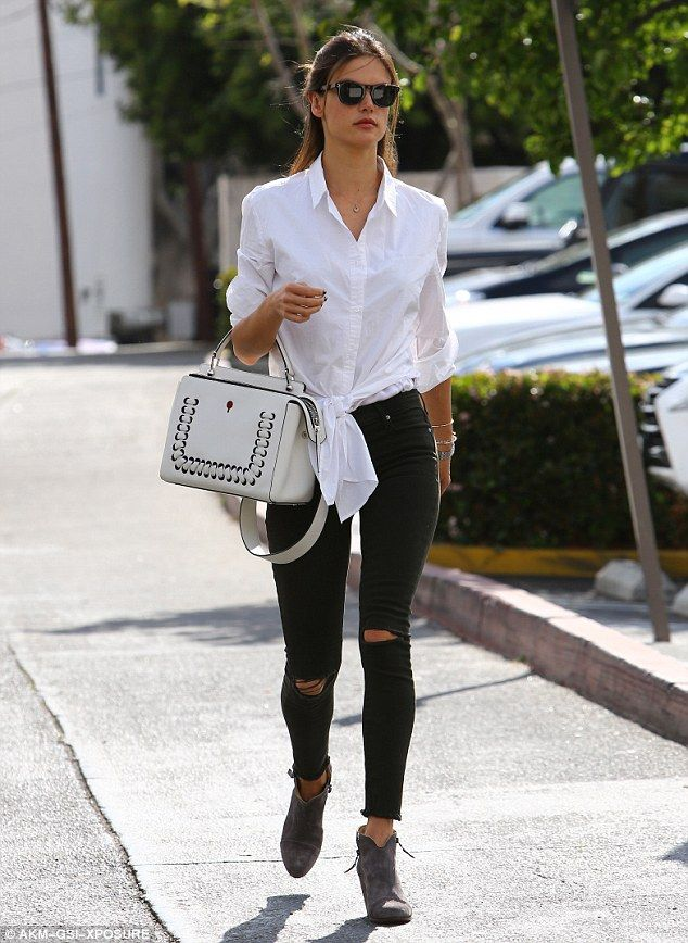 Pricey purse! The supermodelcarried a white leather Fendi handbag that retails for $2900...