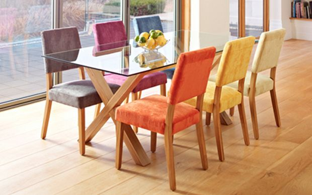 Different Coloured Dining Chairs By A Oak And Glass Dining Table
