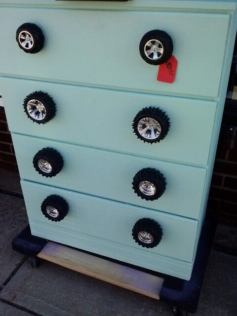 Dresser with toy car wheels for drawer pulls