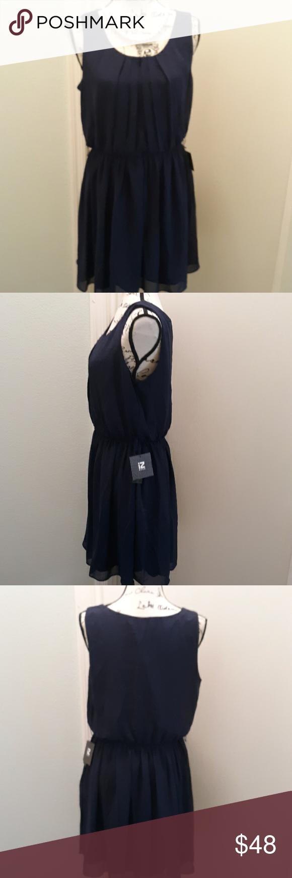 NWT Iz Byer Navy pleated dress size XL NWT Iz Byer Navy pleated dress size XL  Fully lined  100% polyester  Perfect for date night or girl's night out  *missing belt* B: 36-44 W: 38-38 H: 40-48 L: 34  #datenight #girlsnightout #whyiposh  #0502 Iz Byer Dresses