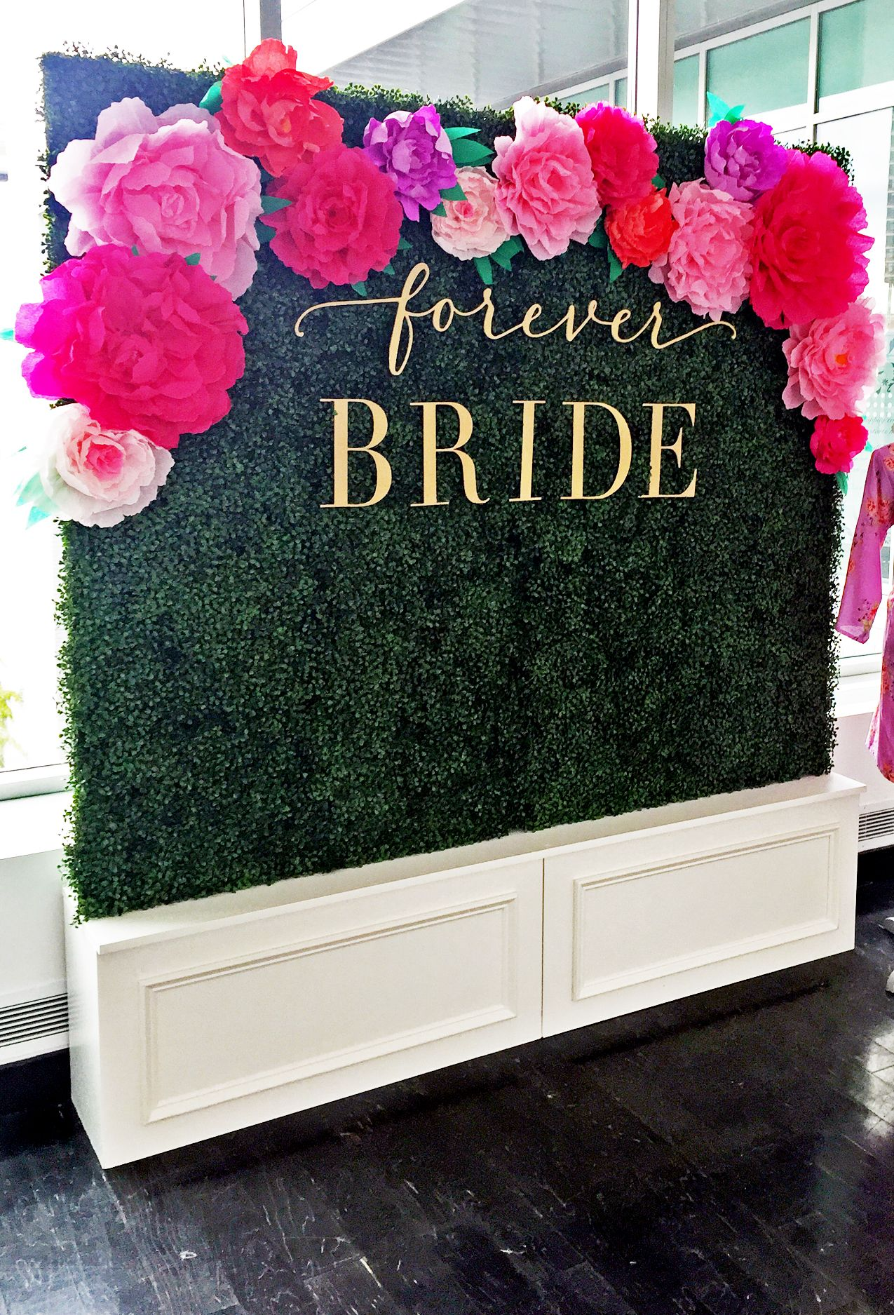 Boxwood backdrop + paper flowers by Girl Friday Wedding