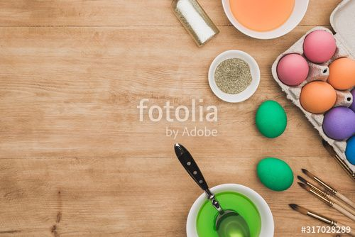 top view of watercolor paints and glitter in bowls near Easter eggs and paintbrushes on wooden table , #Ad, #paints, #glitter, #watercolor, #top, #view #Ad