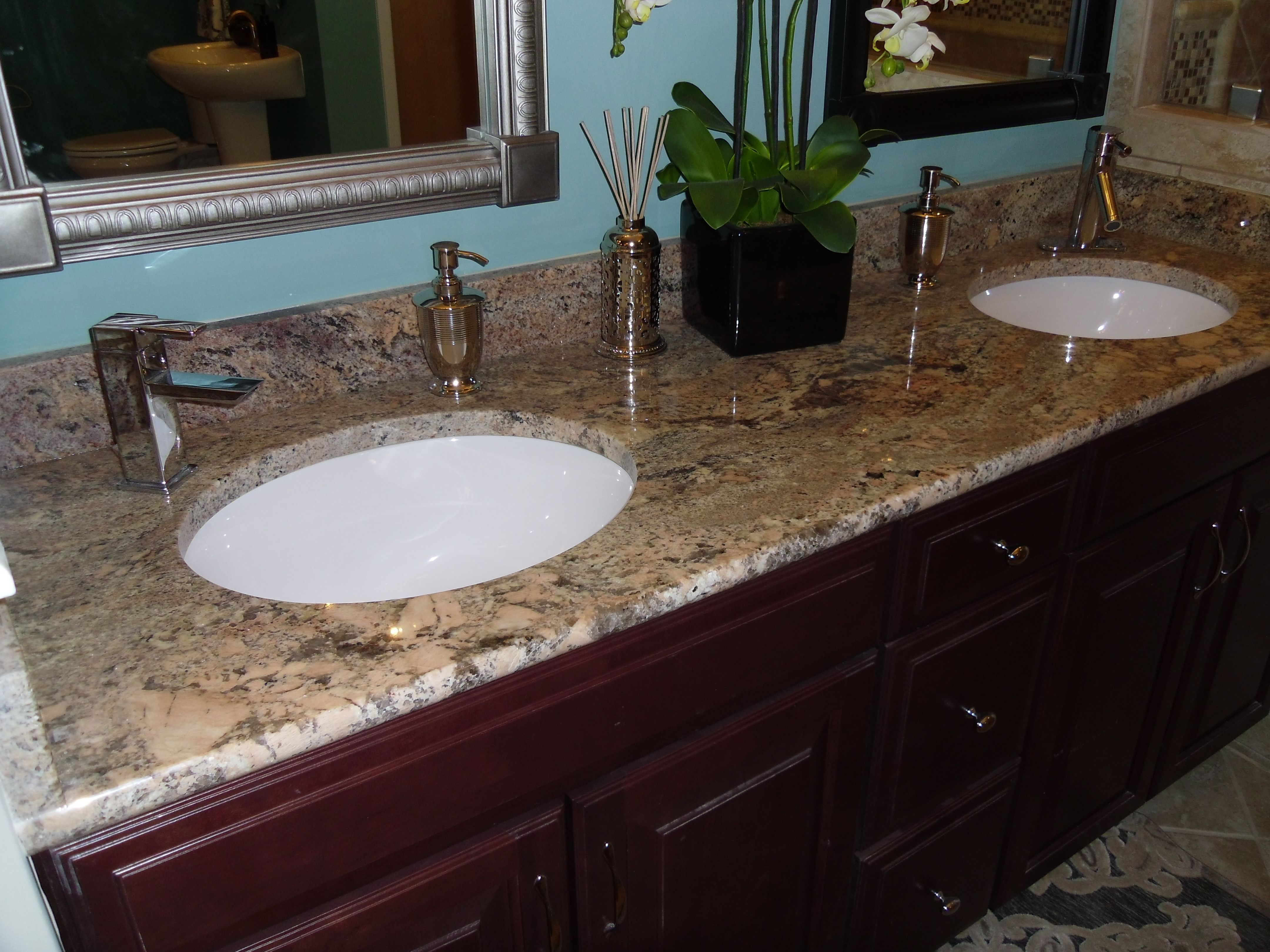 Crema Bordeaux for the bathroom Here they used white sinks Maybe cream toto bone or Kohler almond would go better Undermount sink looks nice