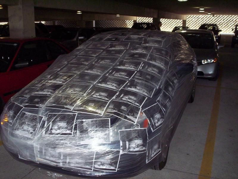 a car covered in pics from a private investigator of a
