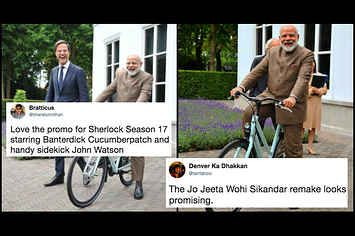 People Have Gone All Out Captioning These Photos Of Narendra Modi On A Cycle
