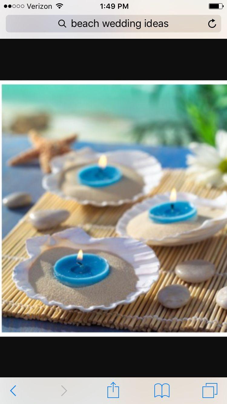 Beach Theme Wedding Centerpieces big shells sand and tea lights