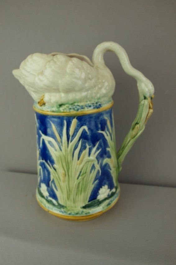 Bevington (attributed) majolica pitcher with swan top