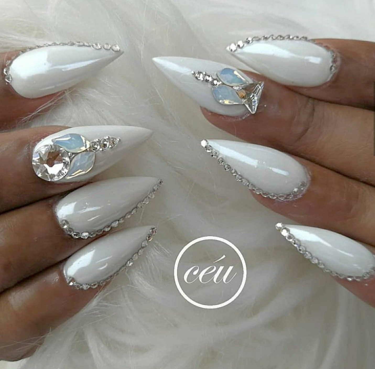 Stiletto Nails Pearl White Nails Nails With Rhinestones Acrylic Nails White Stiletto Nails Nails Design With Rhinestones Stiletto Nails