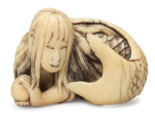 An ivory netsuke of a mermaid By Shuryo, early 19th century